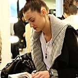 A model read a book ahead of the Iceberg show during Milan Fashion Week for womenswear Autumn/Winter 2009 collections.