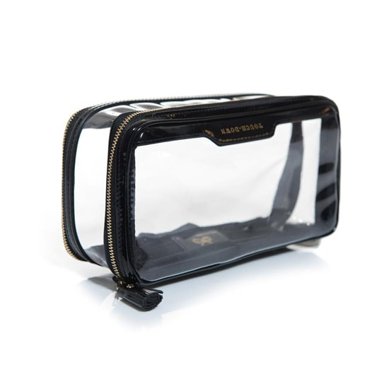 The Anya Hindmarch In-Flight Clear Makeup Bag ($194) is made of sturdy and transparent PVC with patent leather accents, so it's easy to clean if there is a spill. Plus, you won't have to worry about messing up the clothes in your carry-on.