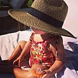 Penelope Disick takes her sun protection very seriously with her mom's wide-brimmed hat. Source: Instagram user kourtneykardash