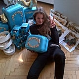 Eniko Mihalik posed with her Anna Dello Russo for H&M luggage. Source: Twitter user enikoeva