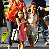 Katie Holmes directed Suri Cruise towards the athletic center in NYC.