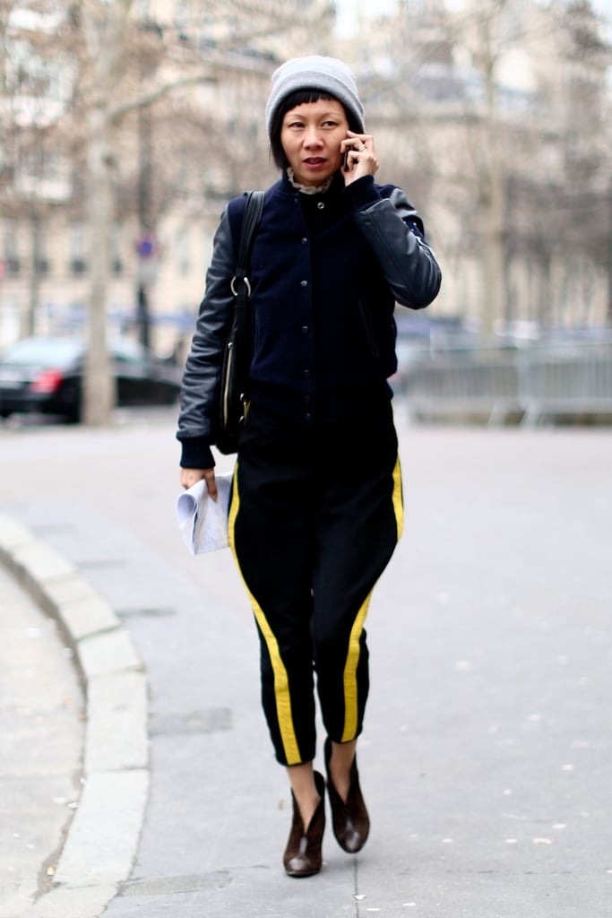A sporty pair of racer-stripe trousers and a leather bomber got a lift with a pair of posh ankle boots.