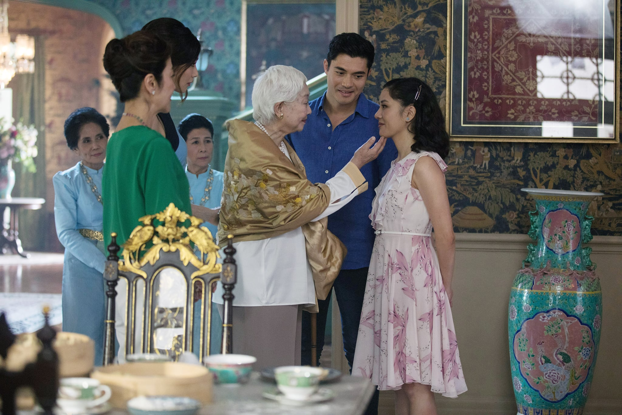 CRAZY RICH ASIANS, foreground from left: Michelle Yeoh, Gemma Chan, Lisa Lu, Henry Golding, Constance Wu, 2018.  Warner Bros. Pictures/courtesy Everett Collection