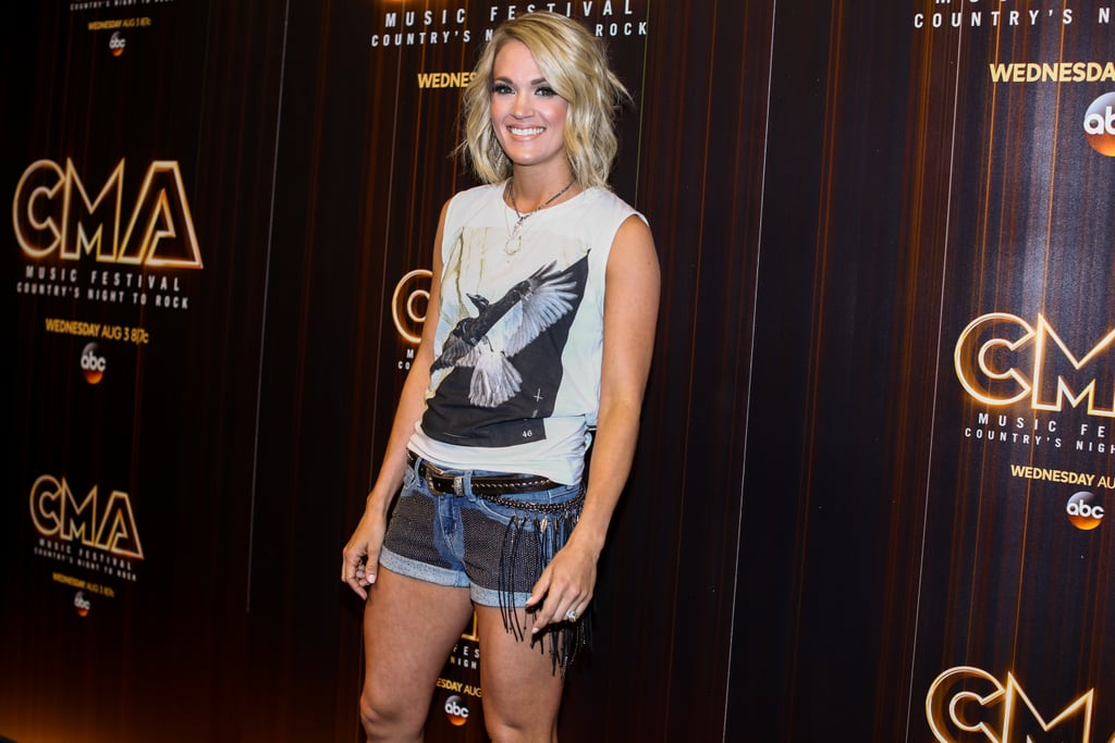 "Following her big night at the CMT Music Awards, Carrie Underwood turned heads when she popped up at the CMA Music Festival in Nashville on Friday. The singer showed off a whole lot of leg in daisy dukes and was all smiles as she did interviews in the press room. Later that evening, Carrie conquered the stage and performed a handful of her hit songs, including ""Church Bells"" and ""Wasted."" Also in attendance was Sam Hunt, who heated up the festival with his gorgeous good looks. Keep reading for more of Carrie, then relive her epic Carpool Karaoke session with James Corden."