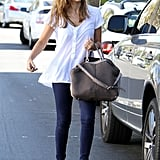 Jessica put a polished twist on the classic jeans-and-white-tee combo with caged Surface to Air sandals and a two-toned Tod's bag in West Hollywood.
