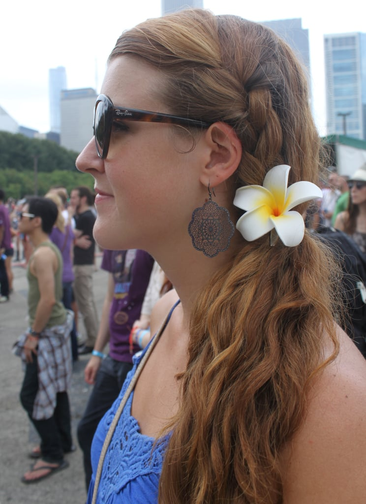 This sideswept ponytail was accented with an easy braid and floral pin.