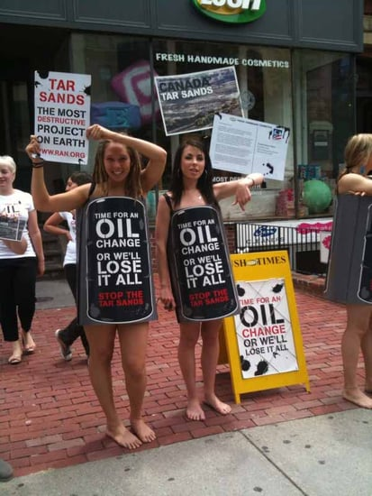 Lush Employees Wear Oil Barrels to Protest Tar Sands