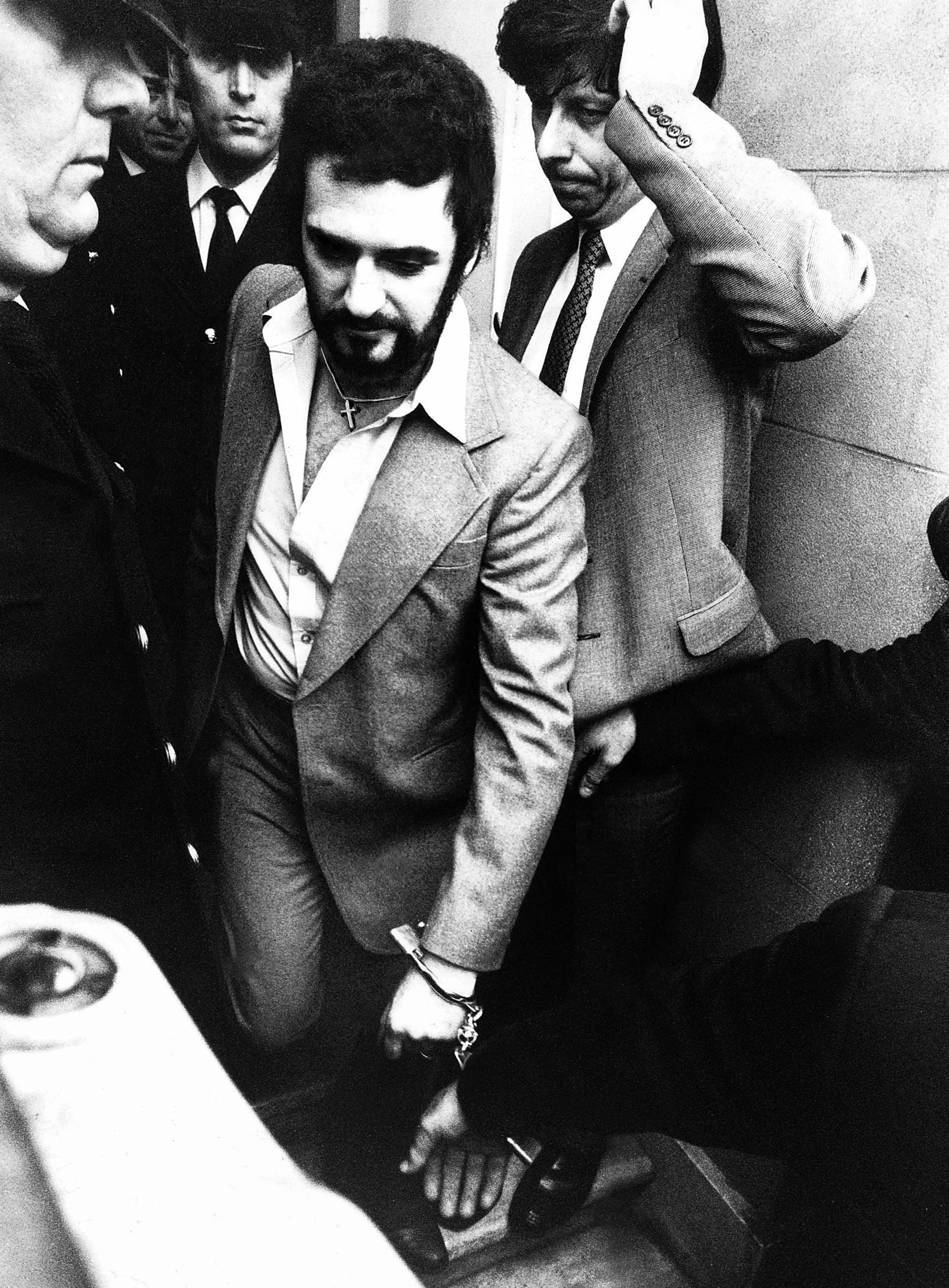 Peter Sutcliffe the Yorkshire ripper handcuffed leaving court msi January 5th 1981 A 35-year-old lorry driver from Bradford, suspected of carrying out 13 murders across West Yorkshire over the past five years, has appeared in court. Peter William Sutcliffe, of 6 Garden Lane, Bradford, is accused of murdering 20-year-old university student Jacqueline Hill, who was killed in Leeds seven weeks ago. (Photo by Stone Peter/Mirrorpix/Getty Images)