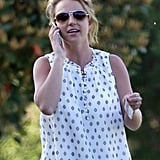 Britney Spears chatted on her phone.