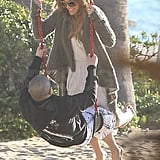 Jennifer Lopez and Casper Smart played together on a swing in Malibu.