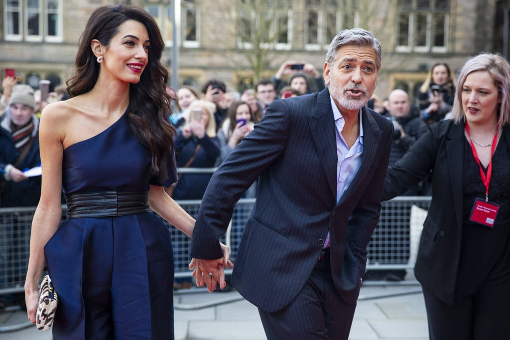 "George and Amal Clooney have made yet another stunning appearance following a glamorous date night at Buckingham Palace. On Thursday, the husband and wife of four years attended the People's Postcode Lottery Charity Gala at Scotland's McEwan Hall, and of course, they looked like a true power duo. While Amal rocked a navy blue jumpsuit with a cinched waist, George remained dapper in a dark suit. At the event, Postcode Lottery — which raises money for charities through a lottery subscription service — honoured the Clooneys for their philanthropic efforts. ""We are thrilled to be attending the People's Postcode Lottery Charity Gala in Edinburgh,"" George and Amal said in a statement. ""It is a perfect setting to highlight the urgent need to protect millions of the world's most vulnerable people from human rights abuses."" George and Amal attended on behalf of their Clooney Foundation for Justice, which aims to promote systematic justice through courtroom and community equality. Ahead, view more photos of their special outing together!      Related:                                                                                                           31 Times George and Amal Clooney Looked Madly in Love"