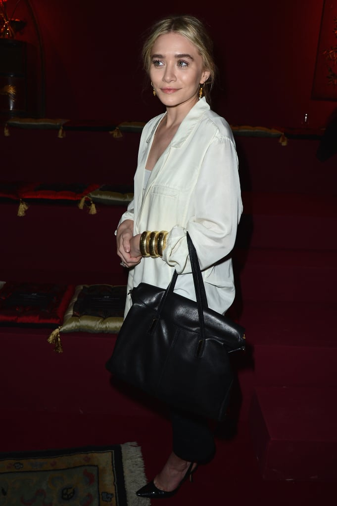 Ashley Olsen donned a black-and-white palette at the H&M fashion show, then finished the look off with three gold bangles and a black Elizabeth and James bag from the Fall 2013 collection.