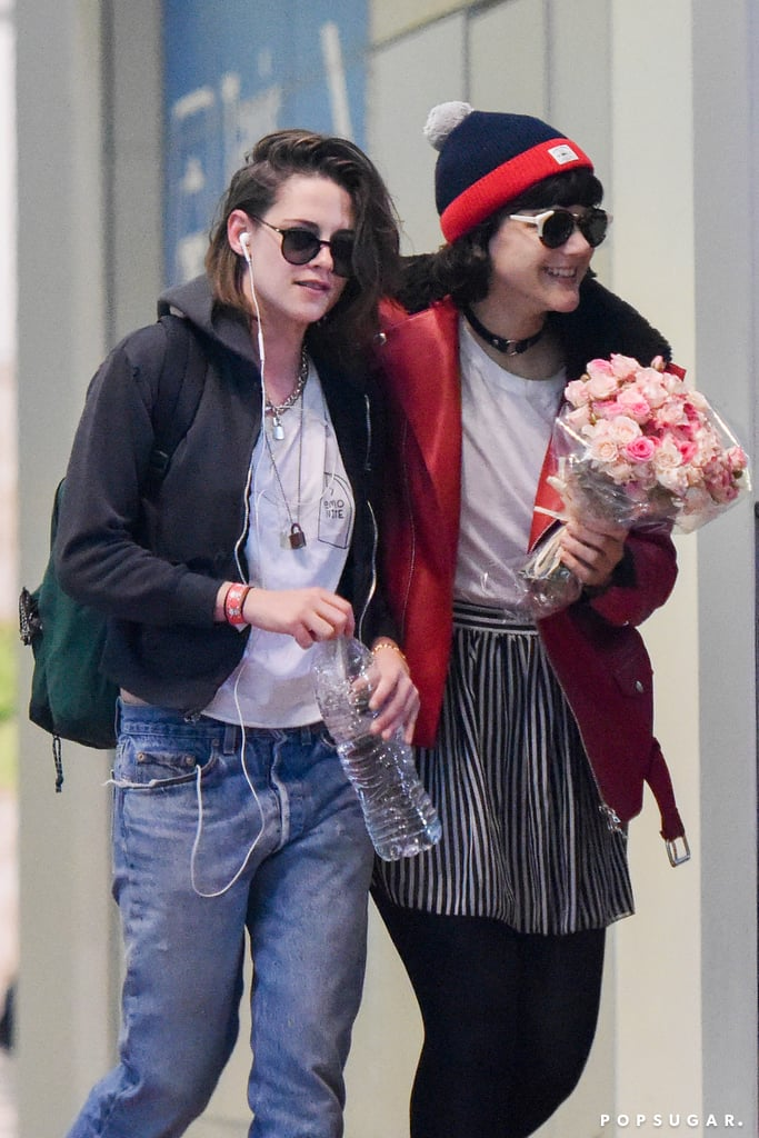 Kristen Stewart got a sweet surprise from her rumored girlfriend, Soko, when she arrived at the Charles de Gaulle Airport in Paris on Sunday. The actress and French singer, who were first linked after a PDA-filled outing in LA earlier this month, made their way through the terminal after Soko waited for her new love with a bouquet of flowers. Later that day, the pair were spotted playing Frisbee in the park with friends while wearing matching Adidas trackpants, and on Monday, they held hands during an afternoon out and about in the city. Kristen has yet to confirm her relationship with Soko — whose real name is Stéphanie Sokolinski — but judging by their recent outings, these two are likely more than friends. Keep reading to see Soko's romantic gesture while welcoming Kristen to Paris.