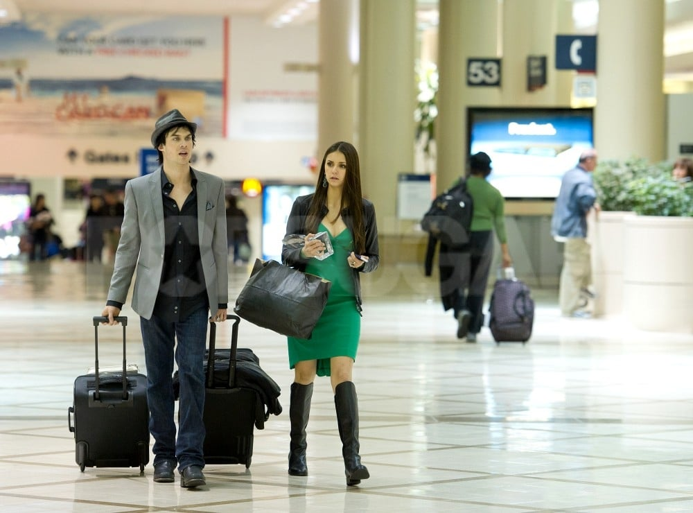 Ian Somerhalder and Nina Dobrev talked at the airport.