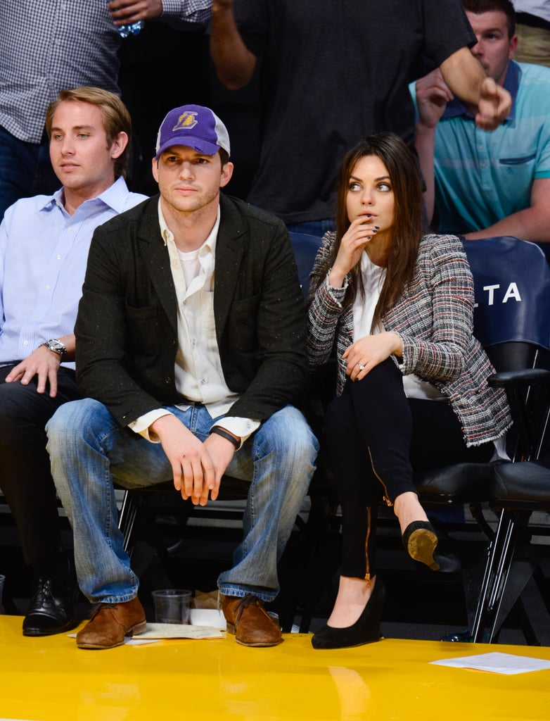 For one of their first appearances as an engaged couple, Mila Kunis and Ashton Kutcher took to the courts. She looked office-appropriate, though, in a tweed jacket, wedges, and zippered skinnies.
