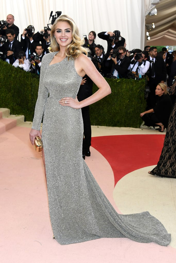 Kate Upton is engaged to Justin Verlander! The Sports Illustrated stunner revealed her gorgeous diamond ring when she hit the red carpet at Monday night's Met Gala in NYC. E! was first to confirm the exciting news after Kate was photographed leaving her hotel in the city and popped up at the event in a glittery gown. Kate and Justin, a starting pitcher for the Detroit Tigers, have been dating for three years. Congrats to the happy couple! Keep reading to see Kate at the Met Gala with her pretty new bauble.
