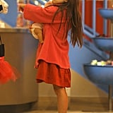 Suri Cruise shopped with her doll.