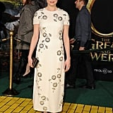 Michelle Williams looked demure and ladylike in a short-sleeved floral dress and a Kate Young for Target metallic gray clutch.