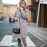 Style Your Checkered Coat With Snakeskin-Print Boots
