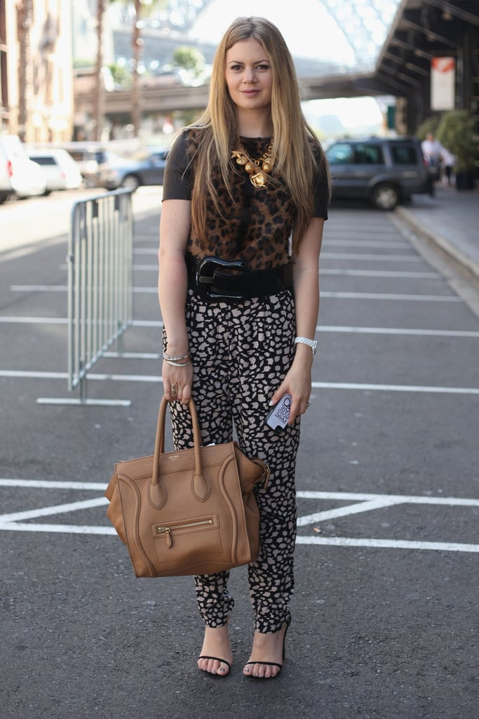 Talk about a daring printed mix — her leopard top and giraffe pants made for quite an eye-catching dynamic. And of course, we love her camel-coloured Céline luggage tote, too.