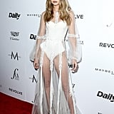 Wearing a sheer Yanina Couture gown over a La Perla bodysuit at the Daily Front Row Awards.