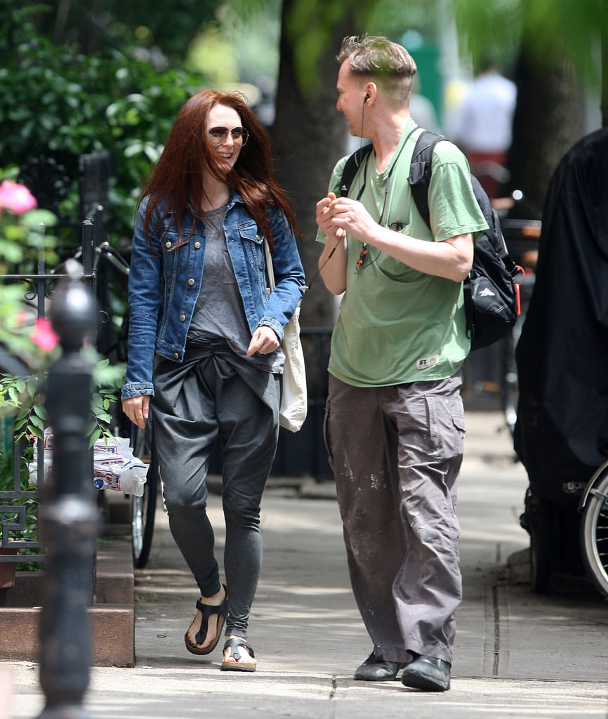 Julianne Moore took her denim jacket on an avant-garde ride by pairing it with gray trousers featuring a dramatic pleated waist.