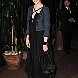 Don't be afraid to mix and match prim pieces, like a tweed jacket, with a sultrier LBD, just as Emma does here in Chanel.