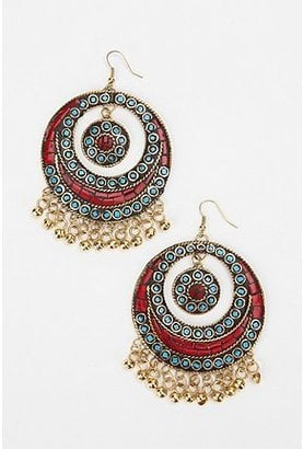 There's no need to pack your weekender with too much stuff. On the jewelry front, all you need is this pair of exotic hoop earrings — perfect for shaking and dancing.  Bali Bell Hoop Earrings ($28)