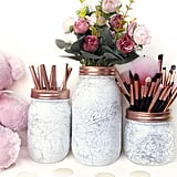 The marble finish on these Marble Brush Holders ($11) is so chic.