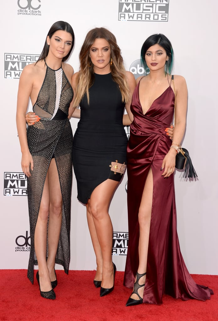 """Khloé Kardashian joined her two younger sisters, Kendall and Kylie Jenner, on the red carpet at the American Music Awards in LA on Sunday night. The reality stars posed for photographs together, with Kylie showing off her infamously plump lips and all three of them showing lots of leg. Kim Kardashian skipped the red carpet this weekend to take a trip to Abu Dhabi to promote her latest fragrance, Fleur Fatale. Kim's press tour has taken her all over the world in the last week, although she ran into a bit of trouble in India. The reality star was forced to cancel an appearance there due to time constraints. Kim wrote on her Instagram, """"When the opportunity presented itself to make the trip, there was a short window to coordinate all the elements necessary to make it happen. Unfortunately time ran out so the trip has been canceled."""""""