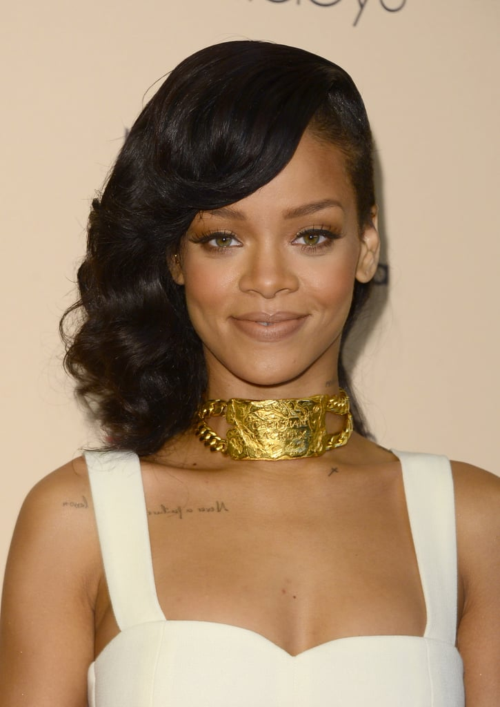 Rihanna accessorized her look with a stunning, vintage gold Christian Lacroix collar necklace and a shimmery neutral makeup palette.
