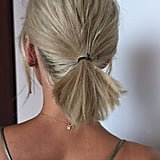 Hair: Pulled Back Messy Ponytail