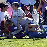 David Beckham wrestled with his sons Cruz and Romeo.