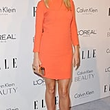 Gwyneth brightened the white carpet at a Beverly Hills Elle event, working a long-sleeved orange mini with neutral sandals, both by Calvin Klein.