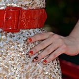 A black and red checkerboard design with gold accents matched Zooey's sparkling ensemble to a T at the 2012 ESPY Awards.