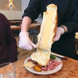 This Restaurant Serves Melted Cheese Wheels Scraped Right Onto Your Plate