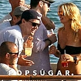 Leonardo DiCaprio chatted up a woman in a bikini.
