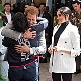 Harry hugged a UK competitor during a reception held by the Prime Minister of Australia in 2018.