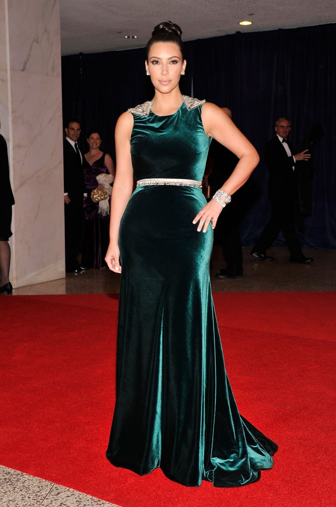 Kim Kardashian showed off her curved in a dark green dress.