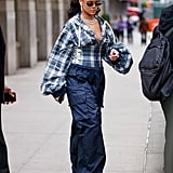 Rihanna left her apartment in 2017 wearing blue Fenty x Puma track pants and a corset-like poufy plaid top.