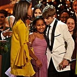 Justin Bieber hugs Sasha Obama at the annual Christmas in Washington gala.
