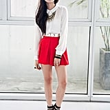 Red pleats are bold on their own, but statement jewels and high-impact platforms take this little skirt from daytime to night out.   Photo courtesy of Lookbook.nu