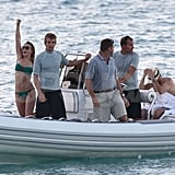 Julianne Hough waved to friends on the beach, while shirtless Ryan Seacrest dried off on their boat.