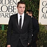 Robert Pattinson posed solo at the Golden Globes.