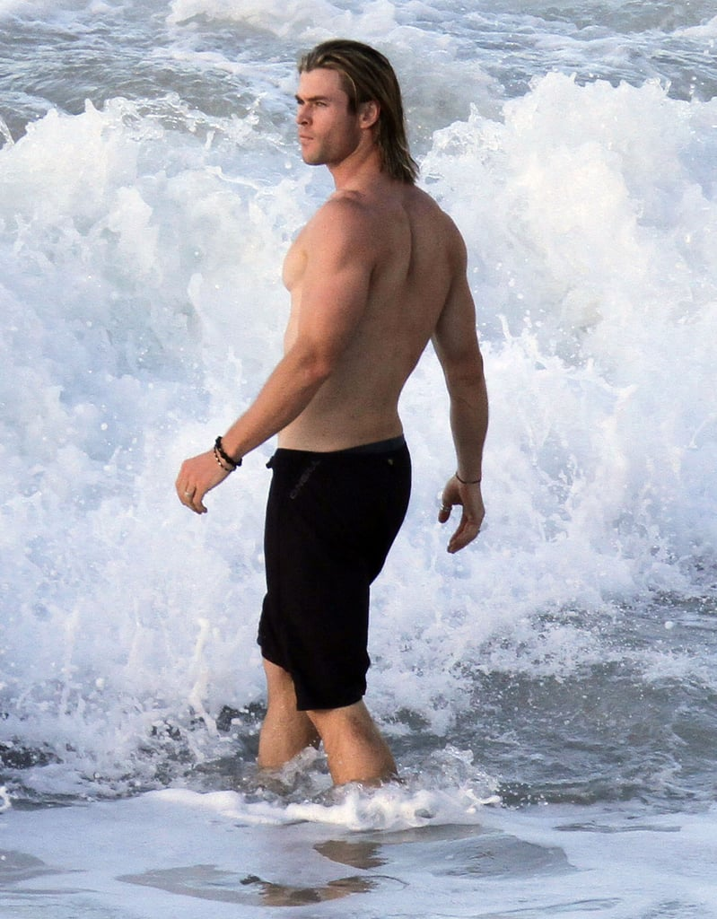 Chris Hemsworth showed off his Thor body with a shirtless strut in the St. Barts waves.