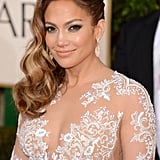 Jennifer Lopez showed up in a jaw-dropping lace Zuhair Murad gown on Sunday night.