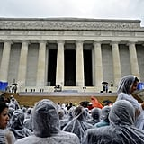 People wore rain ponchos while sitting in their seats for the Let Freedom Ring Commemoration and Call to Action.