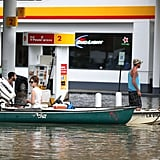 People get gas on boats while traversing a flooded neighborhood in Sorrento, LA.