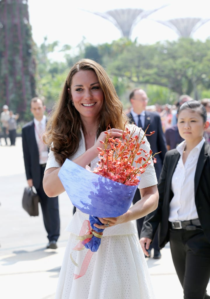 Kate Middleton was presented with flowers in Singapore.