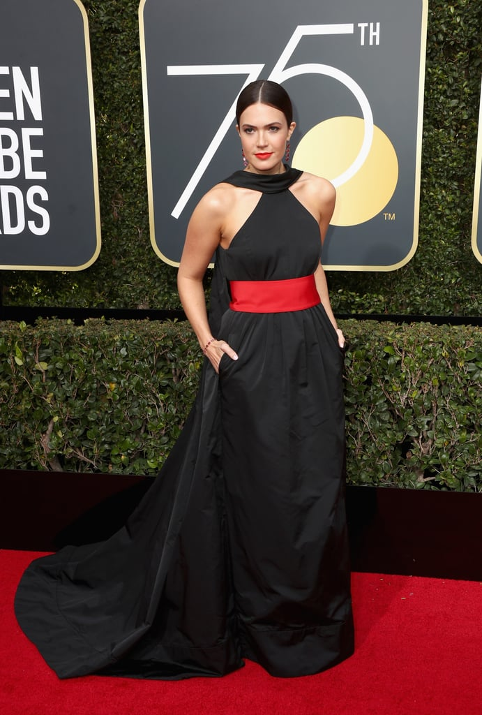 Mandy Moore wearing a Rosie Assoulin dress with Jimmy Choo shoes, Irene Neuwirth jewels, and a Tyler Ellis clutch in 2018.